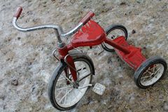 Rustic Red Tricycle Covered in Ice stock image