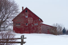 Rustic red winter barn stock photo