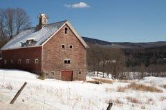 Rustic red winter barn Stock Image