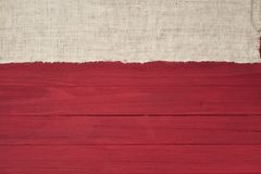 Rustic Red Wood Boards in Flat layout with off white Burlap fabric on top side as decorative design element.  It`s horizontal but