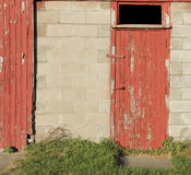 Rustic red wooden barn door background Royalty Free Stock Image