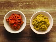 Rustic red and yellow indian curry paste. Close up of bowls of rustic red and yellow indian curry paste Stock Image