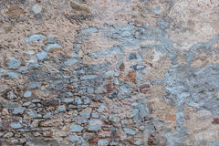 A rustic repaired wall. A wall that has been repaired without much attention for details Stock Image