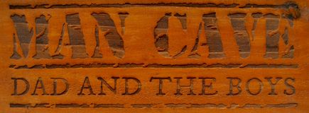 Mancave dad and the boys. Rustic repurposed recycled wood sign engraved, mancave dad and the boys, decoration for workshop, garage or mancave Stock Photos