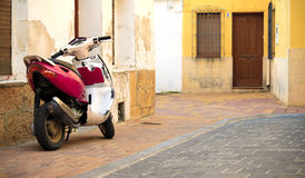Rustic residence and moped Royalty Free Stock Photos