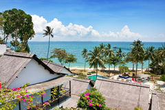 Rustic resort in a tropical island facing the sea Royalty Free Stock Image