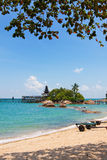 Rustic resort in a tropical island facing the sea Royalty Free Stock Photography