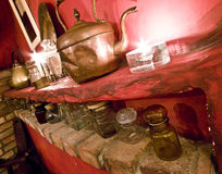 Rustic restaurant detail. Rustic restaurant interior, a wall decoration detail with jars and old kettle Stock Photo