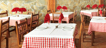 Rustic restaurant tables Stock Image