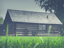 Rustic Retro Filtered Log Cabin. Classic North American Historic Settler Log Cabin With Wagon Wheels Stock Photos