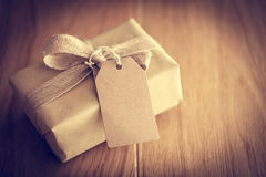 Rustic retro gift, present box with tag. Christmas time, eco paper wrap. Stock Photos