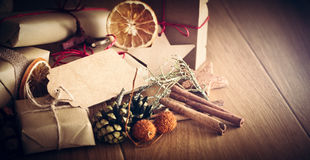 Rustic retro gift, present boxes with decorations. Christmas time, eco paper wrap. Royalty Free Stock Images