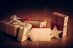 Rustic retro gift, present boxes with tag. Christmas time, eco paper wrap. Stock Image