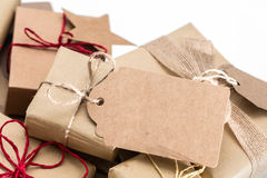 Rustic retro gift, present boxes with tag. Christmas time, eco paper wrap. Stock Photos