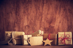 Rustic retro gift, present boxes with tag. Christmas time, eco paper wrap. Stock Images