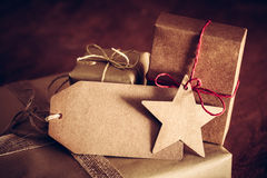 Rustic retro gift, present boxes with tag. Christmas time, eco paper wrap. Stock Photo
