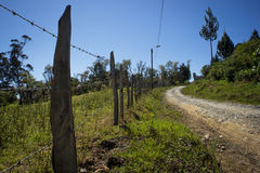 Rustic road. Close with barbed wire and rural road in Colombia Stock Photos