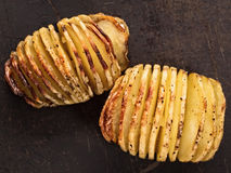 Rustic roasted hasselback potato gratin Stock Photo