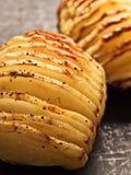 Rustic roasted hasselback potato gratin Stock Photos