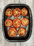 Rustic roasted tomatoes Royalty Free Stock Photography