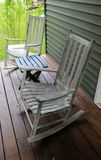 Rustic rocking chairs and table on wood porch Stock Photos