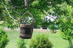 Rustic Romanian wooden well bucket- Valcea region Royalty Free Stock Photos