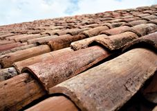 Rustic roof tiles provence france. Old fashioned style roof tiles on rural building in provence france Stock Image