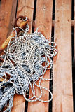 Rustic Rope. A coiled rope on the wooden harbor Royalty Free Stock Photos