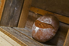 Rustic round bread at wooden shelf Royalty Free Stock Images