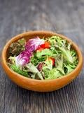 Rustic salad greens Stock Images