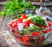 Rustic salad of tomatoes, cucumbers, white onion, red pepper, parsley, seasoned oliveovym oil and balsamic vinegar. Stock Image