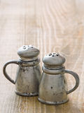 Rustic salt and pepper shaker royalty free stock photography