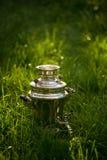 Rustic samovar on the fresh summer lawn. Copyspace Royalty Free Stock Photos