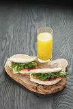 Rustic sandwiches with ham arugula and tomatoes in Stock Images
