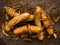 Rustic sausages with caramelised onions Royalty Free Stock Photos