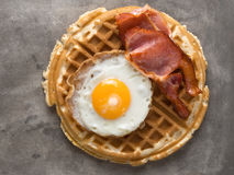 Rustic savory bacon and egg waffle Stock Photography