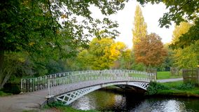 Rustic Scene. Iron  bridge over the River Wandle in Morden Hall Park, borough of Wandsworth,  London Stock Images