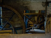 Rustic scene with giant cogwheels and gears. In a workshop royalty free stock photography