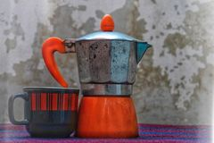 Coffee cup and a kettle. Rustic scenery with a porcelain coffee cup and a kettle royalty free stock photography