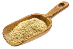 Rustic scoop of flax meal Royalty Free Stock Images