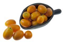 Rustic scoop of kumquats Royalty Free Stock Image
