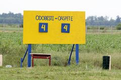 Rustic scoring table at at village football game. With a corn field in background. Score 4-4, equal Stock Photos