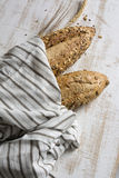 Rustic seeded bread, wrapped in striped fabric Stock Photography
