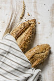 Rustic seeded bread, wrapped in striped fabric Royalty Free Stock Photo