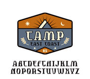 Rustic serif font and camping emblem Stock Images