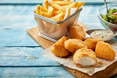 Rustic serving of crumbed fried kibbeling stock photo