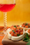 Rustic Setting Of Bruschetta And Wine Royalty Free Stock Photography
