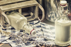 Rustic setting with fresh milk bottles Royalty Free Stock Photography