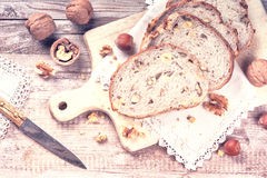 Rustic setting with fresh walnut and hazelnut bread slices Royalty Free Stock Photo