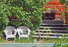 Rustic Setting. Of front yard and porch on  a warm summer day Royalty Free Stock Image